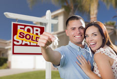 Military Couple In Front of Home, House Keys and Sign Stock Photography