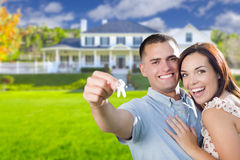 Military Couple with House Keys In Front of New Home Royalty Free Stock Images