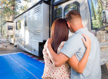 Young Couple Looking At A Beautiful RV At The Campground. royalty free stock photos