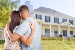 Military Couple Looking at Nice New House Royalty Free Stock Image