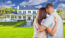 Military Couple Looking at Nice New House Royalty Free Stock Photography