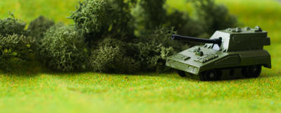 Military diorama. Shallow depth of field picture with a toy tank Stock Photos