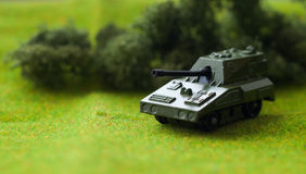 Military diorama. Shallow depth of field picture with a toy tank Royalty Free Stock Image