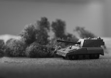 Military diorama. Shallow depth of field picture with a toy tank in black and white Royalty Free Stock Photo