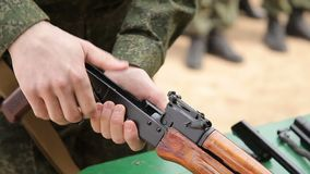 The military dismantles the weapon. Military dismantles Kalashnikov AK-47 assault rifle stock footage