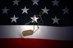 Military dog tag. US Flag as patriotic background Royalty Free Stock Image