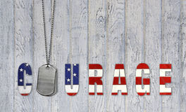 Military dog tags for courage. American flag for courage with military dog tags on weathered barn wood Stock Photo