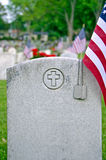 Military dog tags on tombstone Stock Photo