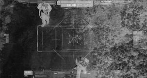 Drone with thermal night vision view of terrorists with camera zooming in