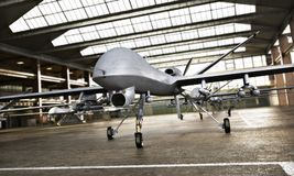 Free Military Drone UAV Aircraft`s With Ordinance In Position In A Hangar Awaiting A Strike Mission. Royalty Free Stock Image - 122653196