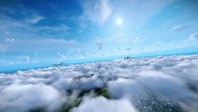 Military drones formation launching missiles, cruising above clouds, ocean and mountain peaks stock video footage