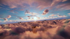 Military drones formation launching missiles, cruising above clouds at sunset stock video