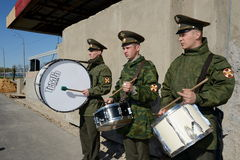 Military drummers marching on the parade ground. Royalty Free Stock Photography