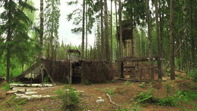 Military earth-houses and huts in the forest. 4K. stock footage