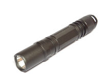 Military electric LED flashlight  on a white Stock Images