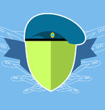 Military emblem . Shield with the aircraft. Blue beret Stock Image
