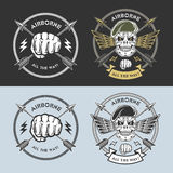 Military emblems. Airborne vector emblems with skull, arrows, wings, beret and fist Stock Images
