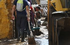 Military emergency unit cleaning after floodings in San Llorenc in the island Mallorca vertical stock photography