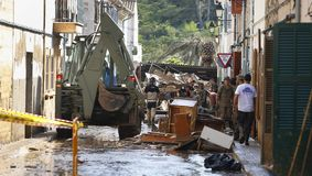 Military emergency unit cleaning after floodings in San Llorenc in the island Mallorca vertical stock photos