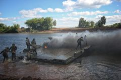 Military engineers cross the river stock images
