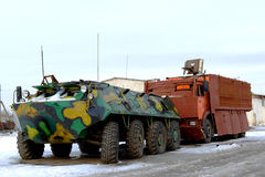 Military equipment - an armored troop-carrier and the truck with Stock Photos