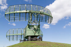 military equipment radio radars in blue sky. Royalty Free Stock Images