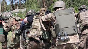 Military exercises in the open countryside stock video footage