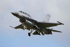 Military F-16 fighter jet landing Stock Image