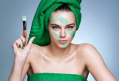 Military facial cream. Serious woman holding up brush. Stock Photo