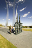 Military family look at Bronze Honor Guard and three soaring spires of the Air Force Memorial, Arlington, Virginia in Washington D Stock Images