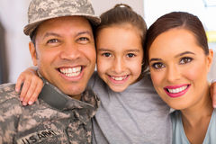 Military family relaxing together. Happy military family of three relaxing together at home Stock Images