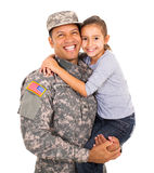 Military father carrying daughter. Portrait of american military father carrying little daughter stock photos