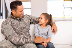 Military father daughter home. Happy military father with his daughter sitting at home royalty free stock photography