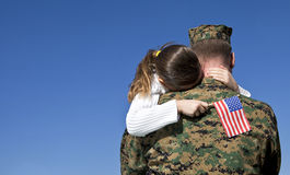 Military Father and Daughter Reunited. Military man hugs his child Royalty Free Stock Images