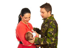 Military father meet his family. Military father came home to his wife and newborn baby isolated on white background royalty free stock photography