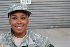 Military female smiling with copy space royalty free stock photography