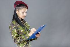 Military female writing in notebook Royalty Free Stock Image