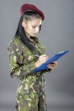 Military female writing in notebook Royalty Free Stock Images