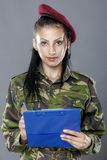 Military female writing in notebook Stock Photo