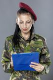 Military female writing in notebook Royalty Free Stock Photos