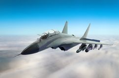 Military fighter aircraft at high speed, flying high in the sky. Royalty Free Stock Photos