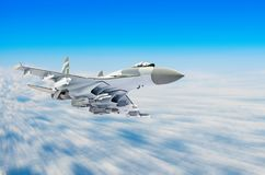 Military fighter aircraft at high speed, flying high in the sky. Military fighter aircraft at high speed, flying high in the sky Royalty Free Stock Images