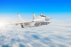 Military fighter aircraft at high speed, flying high in the sky. Military fighter aircraft at high speed, flying high in the sky Royalty Free Stock Photo