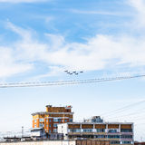 Military fighter aircrafts flight over urban house Stock Photography