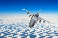 Military fighter jet above the clouds. Royalty Free Stock Photo