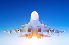 Military fighter jet against a blue sky with a backlight from below. Royalty Free Stock Photography