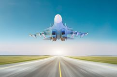 Military fighter jet aircraft at high speed, flying above runway at base. Stock Photo