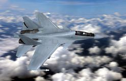 Military fighter jet flying above cloudy sky Stock Photo