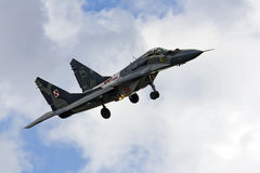 Military fighter Mig 29 Fulcrum on blue sky Royalty Free Stock Image