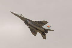 Military fighter plane performs a maneuver. Battle Russian military fighter plane mig-29 in the sky Royalty Free Stock Photography